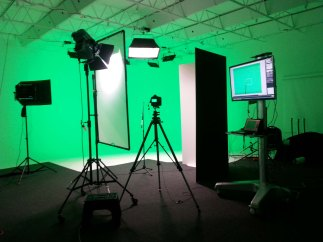 Zylight IS3c LED large panel lights create green and blue chromakey backgrounds on 1300 Studio's cyc without gels or filters.